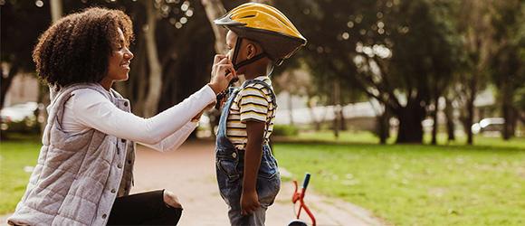 Mom Putting Helmet On Son